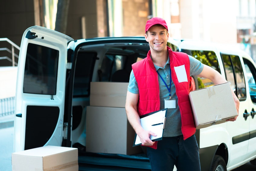 44007115 - colorful picture of courier delivers package. courier holding the box and smiling.